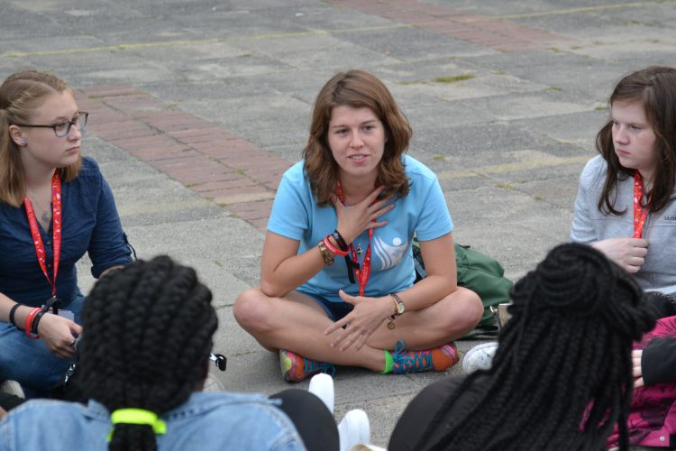A SPEC Volunteer Missionary talking to fellow young people (Photo: WYM)