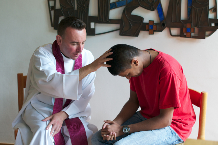A young man at Confession (Photo: WYM)