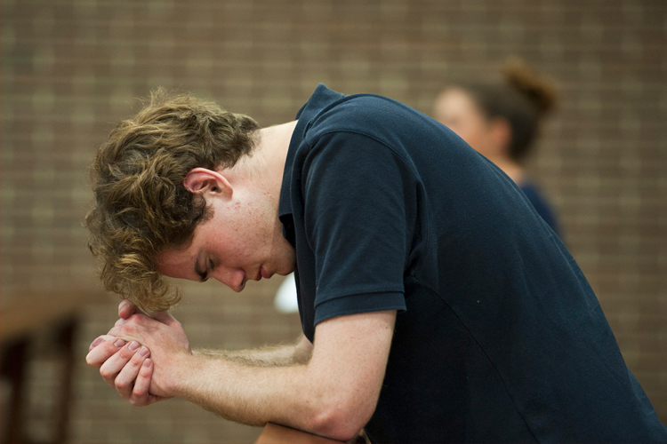 A young man in prayer (Photo: CBCEW)