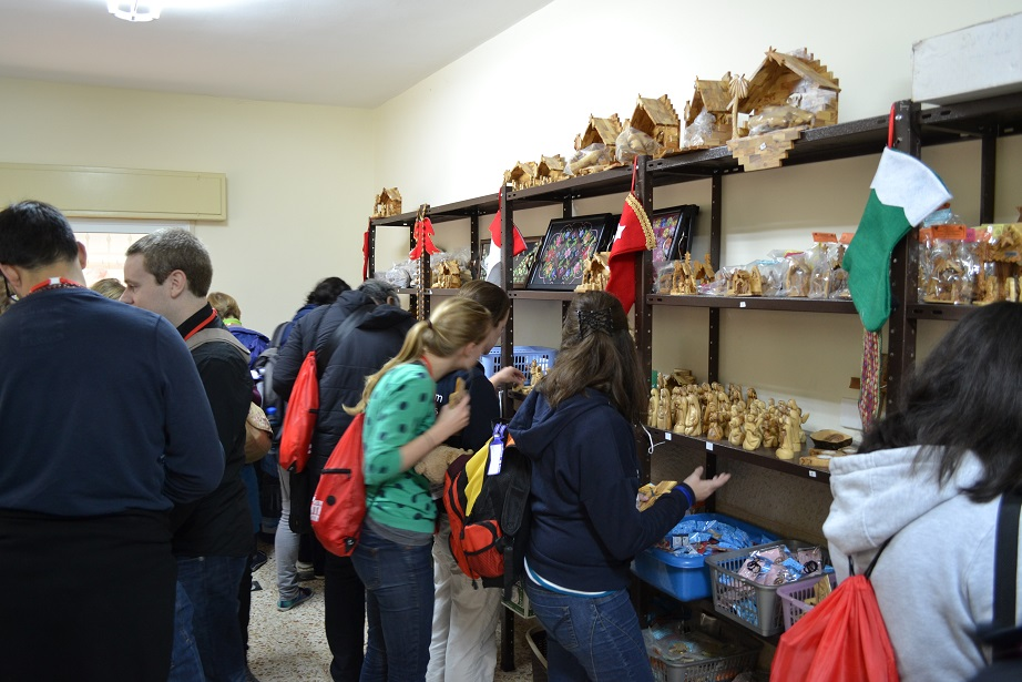Folks checking out the souvenirs made by the students at the School of Joy