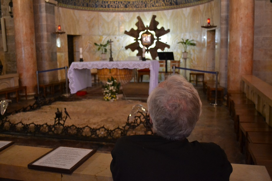 The Cardinal praying in the Church of All Nations
