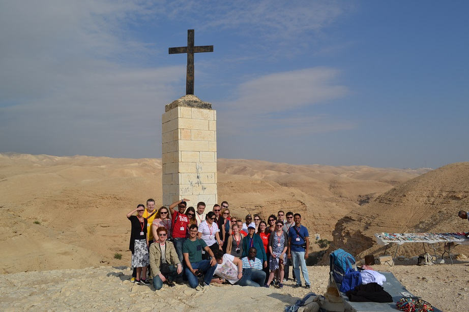 Youth pilgrims by St George's monastery in the desert