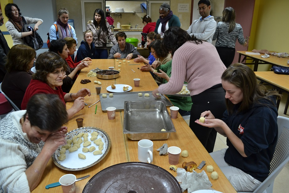 Meeting and greeting the parishioners of Beit Sahour, making pastries for their Christmas party