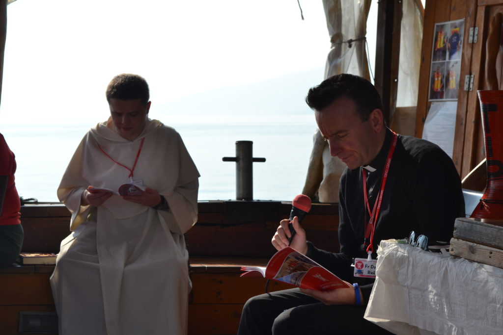 Fr Greg and David during morning prayer on the Sea of Galilee