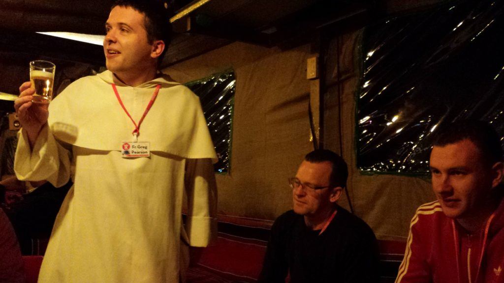 Fr Greg giving a toast before dinner in the Tent