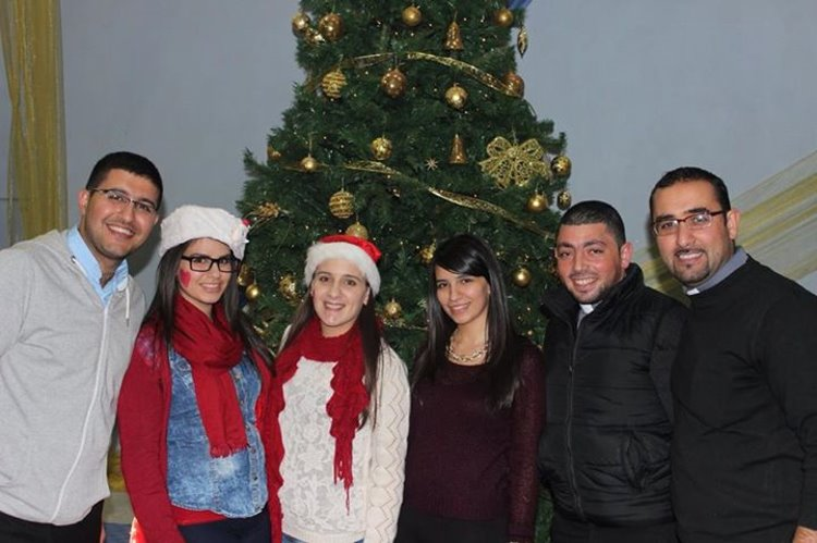 Friends from the Holy Land with a beautiful Christmas tree