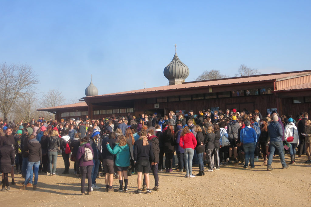 Young people from all over the world gathering outside the church for prayer