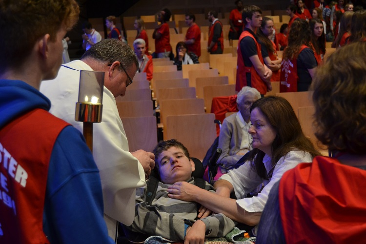 A young person receiving Jesus
