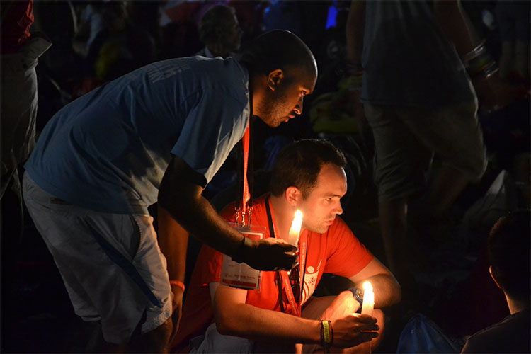 Pilgrims pray at the vigil at Campus Misericordiae (Photo: WYM)