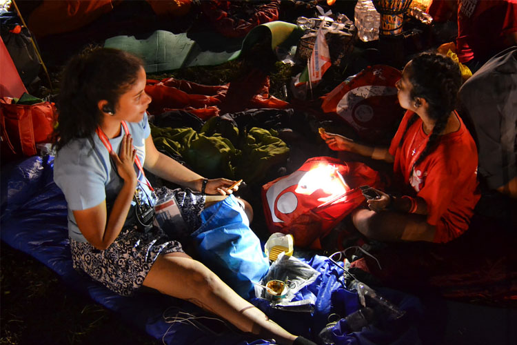 Pilgrims sharing their food at the World Youth Day vigil in Campus Misericordiae (Photo: WYM)