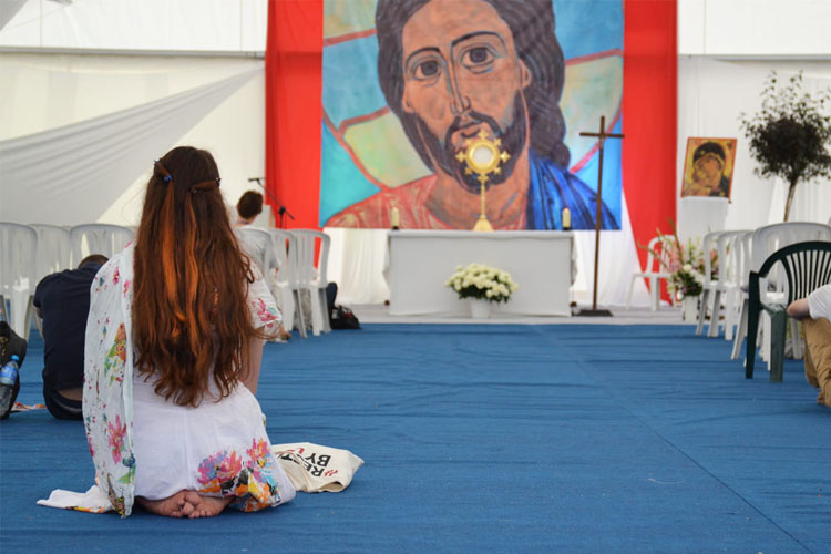 A girl in adoration of Jesus at World Youth Day (Photo: WYM)