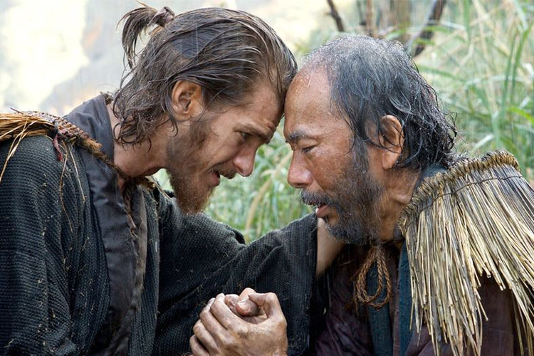 Andrew Garfield as Padre Rodrigues comforting one of the Japanese Christians (Photo: Silence)