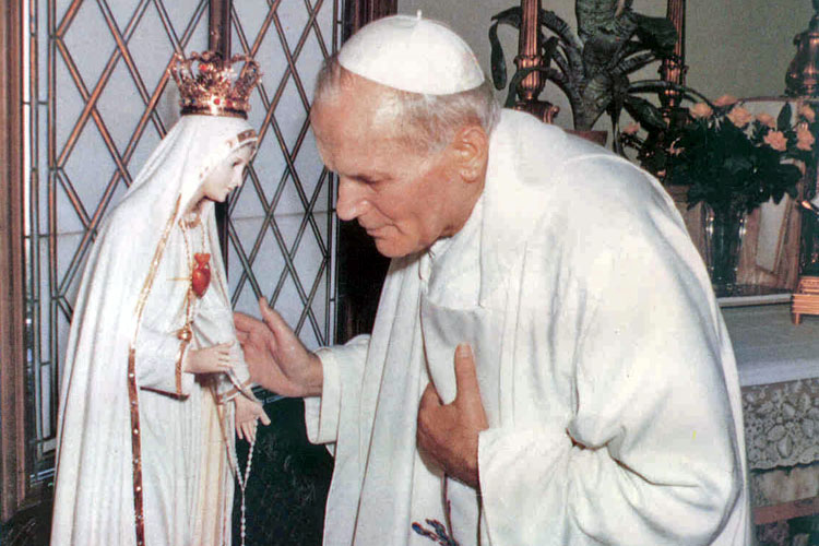 Saint John Paul II by a statue of Mary