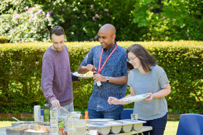 Stan and fellow volunteer missionaries enjoying food out in the gardens